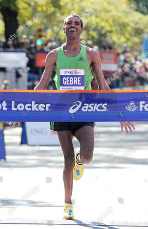 Gebre Gebremariam of Ethiopia Celebrates As He Crosses the Finish Line in First Place at the 2010 New York City Marathon in New York New York Usa on 07 November 2010 United States New York