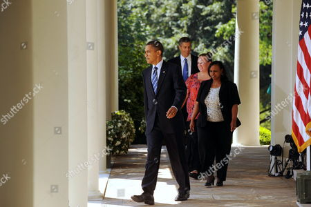 Us President Barack Obama (l) Walks Down the Colonnade with the Us Secretary of Education Arne Duncan (back) and Two School Teachers to Make a Statement Urging the House of Representatives to Pass a Package of Relief to States and Funding in the Rose Garden of the White House Washington Dc Usa 10 August 2010 the House is Poised to Vote on the Medicaid and Education Funding Package 10 August 2010 After Speaker Nancy Pelosi Called Congress Back From Summer Recess For the Vote Also in the Picture is Shannon Lewis (2nd Back) a Teacher That Taught at Hampshire High School in Romney West Virginia and Rachel Martin (front R) a Teacher That Taught Kindergarden at Richton Square School in Richton Park Illinois Both Teachers Are Awaiting Passage of the Legislation to Be Rehired United States Washington