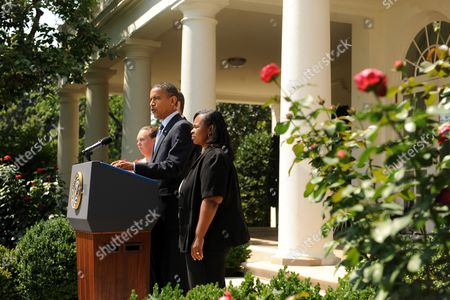 Us President Barack Obama (c) Makes a Statement Urging the House of Representatives to Pass a Package of Relief to States and Funding Aimed at Saving About 160 000 Teacher Jobs Across the Country in the Rose Garden of the White House Washington Dc Usa 10 August 2010 the House is Poised to Vote on the Medicaid and Education Funding Package 10 August 2010 After Speaker Nancy Pelosi Called Congress Back From Summer Recess For the Vote Also in the Picture is Shannon Lewis (l) a Teacher That Taught at Hampshire High School in Romney West Virginia and Rachel Martin (r) a Teacher That Taught Kindergarden at Richton Square School in Richton Park Illinois Both Teachers Are Awaiting Passage of the Legislation to Be Rehired United States Washington
