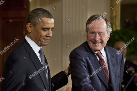 U S President Barack Obama (l) with George Herbert Walker Bush the 41st President of the United States Before Awarding Him with the 2010 Medal of Freedom the Nation's Highest Civilian Honor in a Ceremony in the East Room of the White House in Washington Dc Usa on 15 February 2011 United States Washington