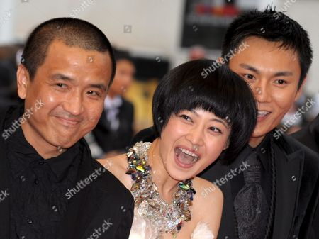 Director Lou Ye Actress Tan Zhuo and Actor Qin Hao Arrive For the Gala Screening of the Chinese Film 'Chun Feng Zui De Ye Wan' (spring Fever) by Lou Ye Running in Competition For the 62nd Edition of the Cannes Film Festival in Cannes France 14 May 2009