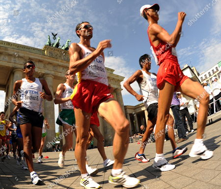 Third Placed Mexican Eder Sanchez (l) and Spanish Francisco Javier Fernandez (c) Pass by the Brandenburg Gate During the 20km Walk at the 12th Iaaf World Championships in Athletics Berlin Germany 15 August 2009