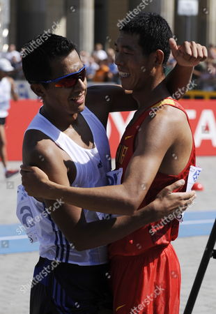 Chinese Hao Wang (r) Who Placed Second and Mexican Eder Sanchez Who Placed Third After the 20km Walk at the 12th Iaaf World Championships in Athletics Berlin Germany 15 August 2009