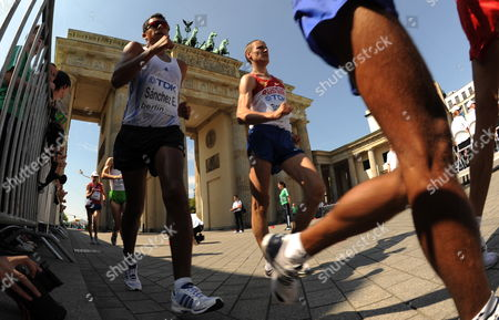 Second Placed Mexican Eder Sanchez (l) and Winnrer Valeriy Borchin of Russia Pass by the Brandenburg Gate During the 20km Walk at the 12th Iaaf World Championships in Athletics Berlin Germany 15 August 2009