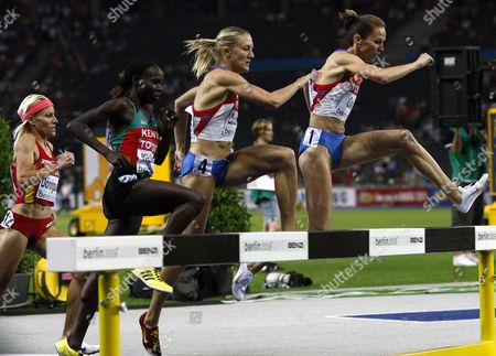 Spanish Marta Dominguez (l) Competes in the 3000m Steeplechase Final at the 12th Iaaf World Championships in Athletics Berlin Germany 17 August 2009 Other Athletes: (2-l - R) Gladys Jerotich Kipkemoi (kenya) Yuliya Zarudneva Gulnara Galkina (both Russia)