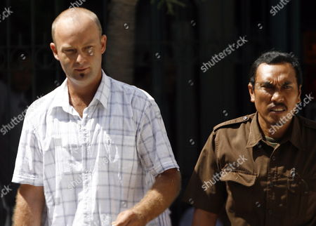 Stock Picture of Australian Jason Scott Mcintyre (l) is Escorted by Court Officer For His Verdict Trial at a Denpasar District Court in Bali Indonesia On 27 July 2009 Indonesian Judges Sentenced Jason to Eight Month in Prison Over Possessing Five Grams of Marijuana
