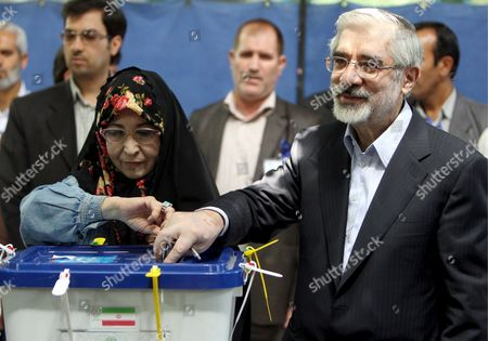 Iranian Presidential Candidate Mir-hossein Moussavi and His Wife Zahra Rahnavard Cast Their Ballots at a Polling Station at the Ershad Mosque in Southern Tehran Iran 12 June 2009 Moussavi is the Main Challenger of Incumbent President Mahmoud Ahmadinejad in Presidential Election More Than 46 Million Iranians Are Eligible to Vote and a Record Turnout is Expected to Be Reached the Four Candidates Are Incumbent President Ahmadinejad Former Prime Minister Mir-hossein Moussavi Former Parliament Speaker Mehdi Karrubi and Former Revolutionary Guards Commander Mohsen Rezaie Epa/abedin Taherkenareh