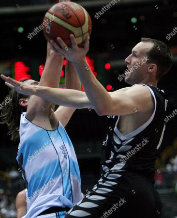 Philip Jones (r) of New Zealand and Fabricio Oberto (l) of Argentina in Action During Their Fiba World Basketball Championships Match in Saitama Japan On Saturday 26 August 2006