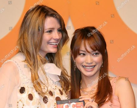Mischa Barton (l) Actress in Popular Fox Television Series the Oc Holds a Japanese Copy of the Programs Dvd with Japanese Talent Yuri Ebihara (r) at a Press Conference in Tokyo Wednesday 30 January 2007 Barton Who Plays the Character Marissa Cooper in the Oc Tv Series is in Tokyo to Promote the Japan Release of the the Oc Dvd Scheduled For March 23rd