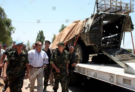 Stock Picture of Spanish Defence Minister Jose Antonio Alonso (c) the Commander of Spanish Troops in Lebanon General Ramon Martin-ambrosio (l) and Lieutenant General Bernardo Alvarez Del Manzano (r) Inspect a Damaged United Nations (un) Vehicle Being Removed From the Site of an Explosion in the Village of Khiyam Southern Lebanon 25 June 2007 a Car Bomb 'Most Likely' Driven by a Suicide Bomber Killed Six Un Peacekeepers in South Lebanon On 24 June a Police Source Said