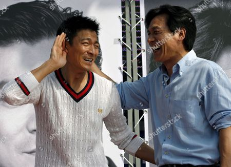 Chinese Actor Andy Lau(l) with South Korean Actor Ahn Sung-ki(r) During a Press Conference at 11th Busan International Film Festival in Busan South Korea Friday 13 October 2006 11th Piff is Preparing to Leap Into the Next 10 Years with a Secured Footing On the Last 10years Achievements Piff Became One of the Most Important Film Festivals in Asia