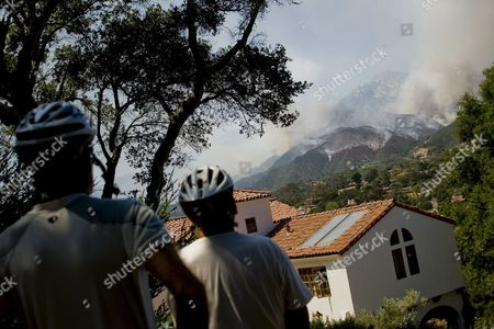 Frank Hudson (r) and Peter Moffat (l) of Goleta Watch the Jesusita Fire Burn On Its Second Day in the Foothills Above Santa Barbara California Usa 06 May 2009 Thousands of People Were Ordered to Evacuate Their Homes On 05 May As Fire Crews Work to Contain the Blaze