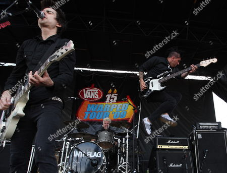Jusin Sane (l) Pat Thelic (c) and Chris Head (r) of the Us Band Anti-flag Perform During Their Concert Performance at the Warped Tour in Indianapolis Indiana Usa 07 July 2009