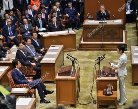 Leader of the Democratic Party, Renho Murata Murata (R) questions to Prime Minister Shinzo Abe during the debate with party leaders at the Upper House of the Diet in Tokyo, Japan,.