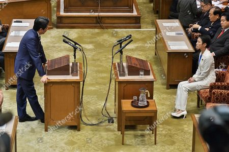 Japan's Prime Minister Shinzo Abe (L) answers question from Leader of the Democratic Party, Renho Murata during the debate with party leaders at the Upper House of the Diet in Tokyo, Japan,.