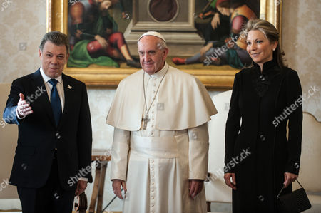 President of Colombia Juan Manuel Santos Calderon and wife Maria Clemencia Rodriguez Munera with Pope Francis during the private audience