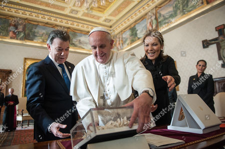 Pope Francis with Colombian president Juan Manuel Santos Calderon and his wife Maria Clemencia Rodriguez Munera during the private audience