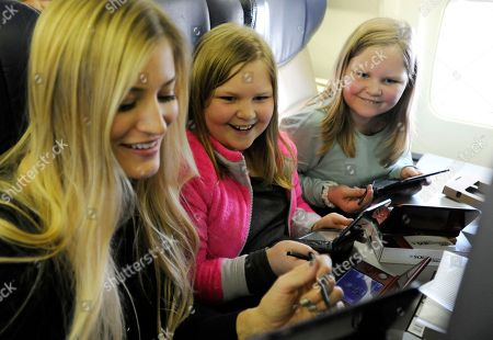 In this photo provided by Nintendo of America, Nintendo surprises passengers on a Southwest Airlines flight from Dallas Love Field to Los Angeles International Airport on Wednesday, Dec. 14. In the air, actress and YouTube celebrity iJustine and Morgan H. and Marley H. of Fort Worth, Texas, play Super Mario Maker for Nintendo 3DS. Passengers received New Nintendo 3DS XL systems and a voucher to download Super Mario Maker for Nintendo 3DS from Nintendo eShop. From through Jan. 14, 2017, everyone can get in on the fun and enter the Say Yes to Nintendo 3DS sweepstakes for a chance to win a trip to NYC and Nintendo prize packages