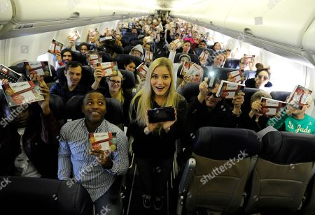 In this photo provided by Nintendo of America, Nintendo surprises passengers on a Southwest Airlines flight from Dallas Love Field to Los Angeles International Airport on Wednesday, Dec. 14. In the air, actress and YouTube celebrity iJustine helped passengers play and create Super Mario levels using Super Mario Maker for Nintendo 3DS. Passengers received a New Nintendo 3DS XL system and a voucher to download Super Mario Maker for Nintendo 3DS from Nintendo eShop. From through Jan. 14, 2017, everyone can get in on the fun and enter the Say Yes to Nintendo 3DS sweepstakes for a chance to win a trip to NYC and Nintendo prize packages
