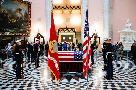 Marines stand guard at the casket of John H Glenn, in Columbus, Ohio. Glenn's home state and the nation began saying goodbye to the famed astronaut who died last week at the age of 95