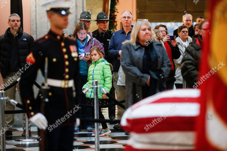 Mourners arrive to view the casket of John H Glenn, in Columbus, Ohio. Glenn's home state and the nation began saying goodbye to the famed astronaut who died last week at the age of 95