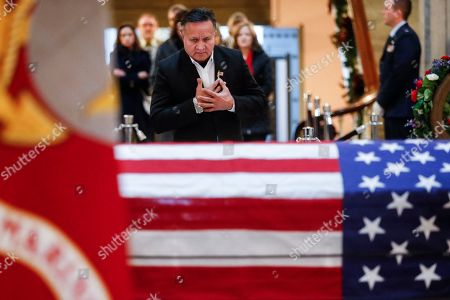 Mourners arrive to view the casket of the John H Glenn as he lies in repose, in Columbus, Ohio. Glenn, 95, the first American to orbit Earth, died last week