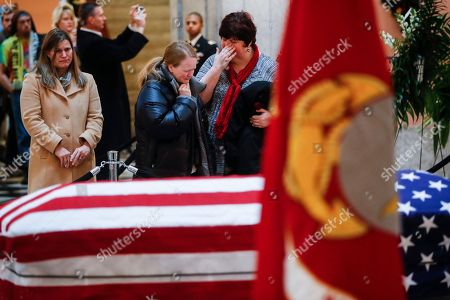 Mourners cry as they view the casket of John H Glenn, in Columbus, Ohio. Glenn's home state and the nation began saying goodbye to the famed astronaut who died last week at the age of 95