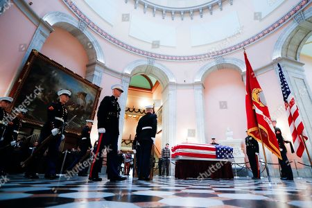 Marines guard the casket of John H Glenn, in Columbus, Ohio. Glenn's home state and the nation began saying goodbye to the famed astronaut who died last week at the age of 95