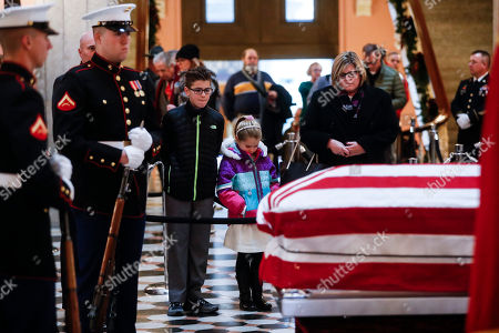 Mourners pause at the casket of John H Glenn as he lies in honor, in Columbus, Ohio. Glenn's home state and the nation began saying goodbye to the famed astronaut who died last week at the age of 95