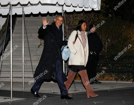 Barack Obama, Sasha Obama President Barack Obama and his daughter Sasha Obama walks towards Marine One helicopter prior to their departure from the South Lawn of the White House in Washington, for the short trip to nearby Andrews Air Force Base, . Obama and his family are traveling to Hawaii for the holidays