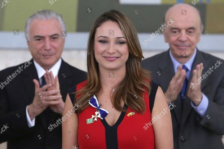 Michel Temer, Jose Serra, Monica Patricia Jaramillo Giraldo Caracol TV presenter Monica Patricia Jaramillo Giraldo poses for pictures with Brazil's President Michel Temer, left, and Brazil's Foreign Minister Jose Serra, during a decoration ceremony honoring Colombians who helped in the rescue and recovery of the victims of the chartered plane crash involving members of a Brazilian soccer team and a group of journalists, at the Planalto presidential palace, in Brasilia, Brazil, . The pilot reported the plane was out of fuel minutes before it slammed into a muddy mountainside near Medellin on Nov. 28, killing all but six of the 77 people on board