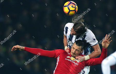 United's Zlatan Ibrahimovic heads with Albion's Jonas Olsson