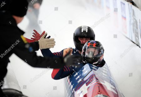 Steven Holcomb, Carlo Valdes Driver Steven Holcomb, front, and brakeman Carlo Valdes, of the United States, react in the finish area after their second run of the men's two-man bobsled World Cup race, in Lake Placid, N.Y