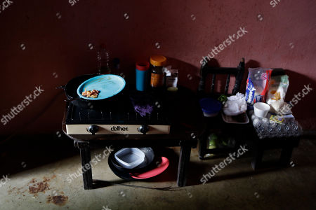 An Electric Burner And The Familys Meager Food Supplies Are Seen In The Rented Room That