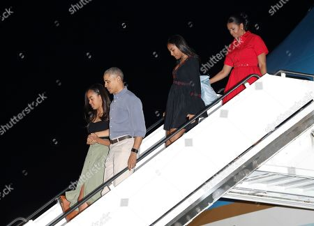 Barack Obama, Michelle Obama, Sasha Obama, Malia Obama U.S. President Barack Obama and first lady Michelle Obama, with their daughters Malia, left, and Sasha, second right, arrive on Air Force One, at Joint Base Pearl Harbor-Hickam, adjacent to Honolulu, Hawaii, for their annual family vacation on the island of Oahu