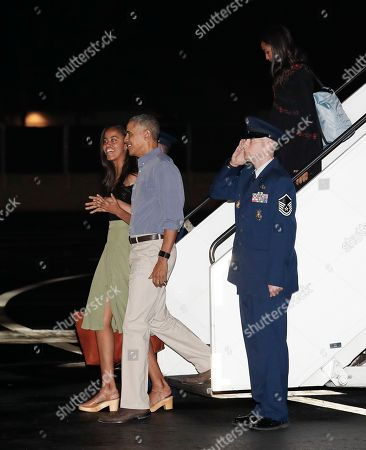 Barack Obama, Sasha Obama, Malia Obama President Barack Obama and his daughters Malia, left, and Sasha, right, arrive on Air Force One, at the Joint Base Pearl Harbor-Hickam, adjacent to Honolulu, Hawaii, for their annual family vacation on the island of Oahu