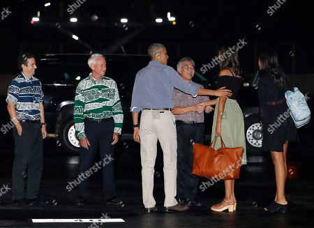 Barack Obama, Michelle Obama, Sasha Obama, Malia Obama, David Ige, Kirk Caldwell, Brian Schatz U.S. President Barack Obama, center, and his daughters, Malia, second from right, and Sasha, right, are greeted as they arrive on Air Force One, at Joint Base Pearl Harbor-Hickam, adjacent to Honolulu, Hawaii, for their annual family vacation on the island of Oahu. Greeting the first family from left are Sen. Brian Schatz, D-Hawaii, Mayor of Honolulu Kirk Caldwell, and Hawaii Gov. David Ige