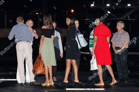 Barack Obama, Michelle Obama, Sasha Obama, Malia Obama, David Ige, Kirk Caldwell, Brian Schatz, Harry Harris, Bruni Bradley U.S. President Barack Obama, left, and first lady Michelle Obama, second from right, with their daughters Malia, third from left, and Sasha, fifth from left, are greeted as they arrive on Air Force One, at Joint Base Pearl Harbor-Hickam, adjacent to Honolulu, Hawaii, for their annual family vacation on the island of Oahu. Greeting the first family from left are Adm. Harry Harris, commander of the U.S. Pacific Command, and his wife Bruni Bradley, Sen. Brian Schatz, D-Hawaii, Mayor of Honolulu Kirk Caldwell, and Hawaii Gov. David Ige