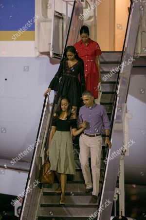 Barack Obama, Malia Obama, Michelle Obama, Sasha Obama U.S. President Barack Obama, first lady Michelle, top, and their daughters, Malia Obama, bottom, and Sasha, exit Air Force One upon their arrival at Joint Base Pearl Harbor-Hickam, in Honolulu, Hawaii, for their annual family vacation on the island of Oahu