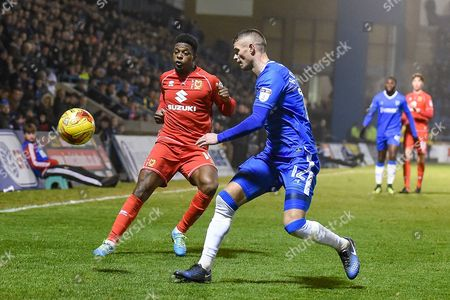 MK Dons forward Kieran Agard (14)  and Gillingham defender Paul Konchesky (12) during the EFL Sky Bet League 1 match between Gillingham and Milton Keynes Dons at the MEMS Priestfield Stadium, Gillingham