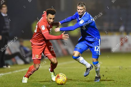 MK Dons forward Nicky Maynard (28) and Gillingham defender Paul Konchesky (12) during the EFL Sky Bet League 1 match between Gillingham and Milton Keynes Dons at the MEMS Priestfield Stadium, Gillingham