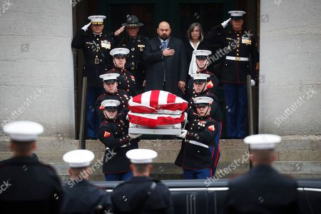 The casket of John H Glenn is carried out of the Ohio Statehouse by Marines during his funeral procession, in Columbus, Ohio. The famed astronaut died Dec. 8 at age 95