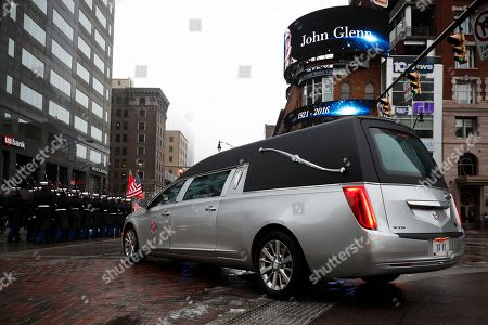 A hearse bearing the casket of John H Glenn is driven away from the Ohio Statehouse during his funeral procession, in Columbus, Ohio. The famed astronaut died Dec. 8 at age 95