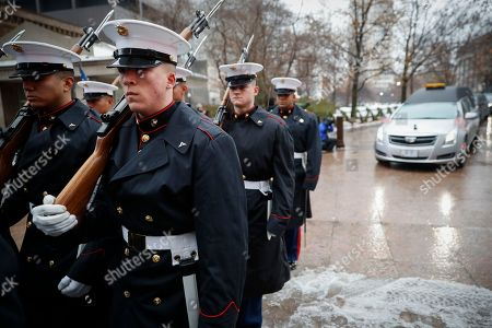 Marines escort a hearse bearing the casket of John H Glenn as he is driven out of the Ohio Statehouse during his funeral procession, in Columbus, Ohio. The famed astronaut died Dec. 8 at age 95