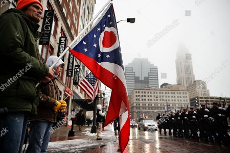 Chip Wendt, Ethan Wendt Chip Wendt, left, and son Ethan, of Mt. Vernon, Ohio, hold flags as Marines escort the hearse bearing the casket of John H Glenn is driven away from Ohio Statehouse during his funeral procession, in Columbus, Ohio. The famed astronaut died Dec. 8 at age 95