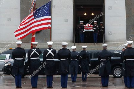 Marines carry the casket of John H Glenn out of the Ohio Statehouse during his funeral procession, in Columbus, Ohio. The famed astronaut died Dec. 8 at age 95