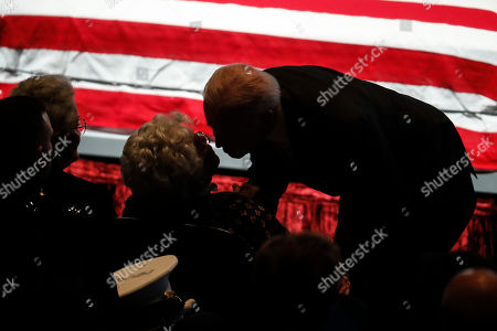 Stock Picture of Joe Biden, Annie Glenn Vice President Joe Biden, right, comforts Annie Glenn, wife of John H Glenn, after speaking at her husband's funeral at The Ohio State University, in Columbus, Ohio. Glenn, the famed astronaut, died Dec. 8 at age 95