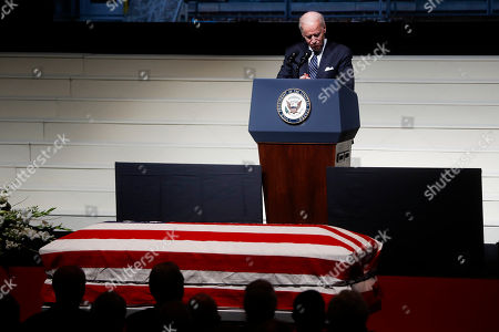 Vice President Joe Biden pauses as he speaks at the funeral of John H Glenn at The Ohio State University, in Columbus, Ohio. Glenn, the famed astronaut, died Dec. 8 at age 95