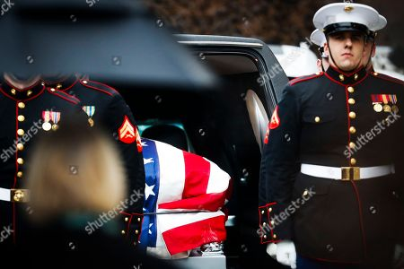 Marines escort the casket of John H Glenn out of the Ohio Statehouse during his funeral procession, in Columbus, Ohio. The famed astronaut died Dec. 8 at age 95