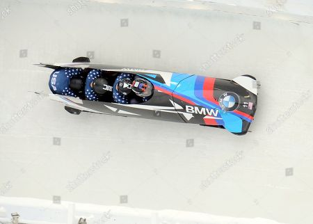 Steven Holcomb, Carlo Valdes, James Reed Samuel McGuffie Driver Steven Holcomb with Carlo Valdes, James Reed and brakeman Samuel McGuffie, of the United States, compete in the four-man bobsled finishing second in World Cup race, in Lake Placid, N.Y